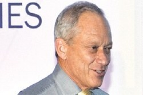 Nicholas E.